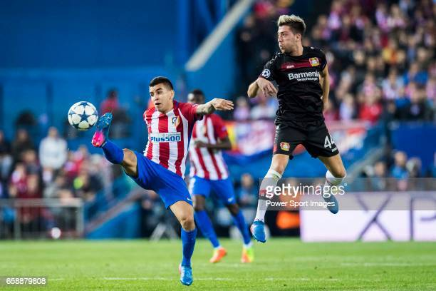 Kevin Kampl of Bayer 04 Leverkusen fights for the ball with Angel Correa of Atletico de Madrid during their 201617 UEFA Champions League Round of 16...