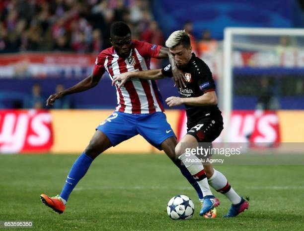 Kevin Kampl of Bayer 04 Leverkusen in action against Thomas of Atletico Madrid during the UEFA Champions League Round of 16 football match between...