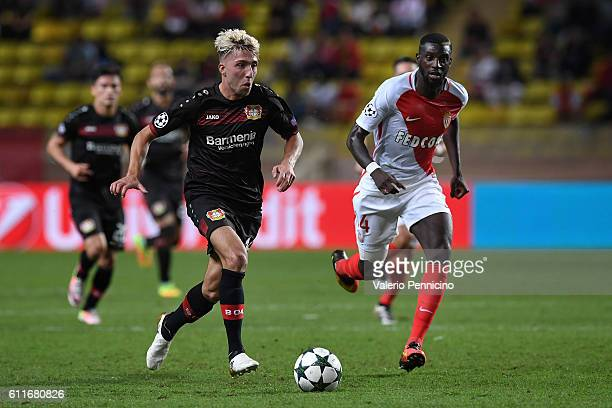 Kevin Kampl of Bayer 04 Leverkusen in action against Tiemoue Bakayoko of AS Monaco FC during the UEFA Champions League Group E match between AS...