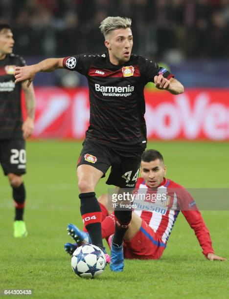 Kevin Kampl of Bayer Leverkusen and Angel Correa of Atletico Madrid controls the ball during the UEFA Champions League Round of 16 first leg match...