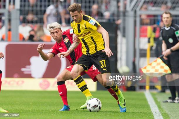 Kevin Kampl of Bayer Leverkusen and Erik Durm of Dortmund battle for the ball during the Bundesliga match between Borussia Dortmund and Bayer 04...