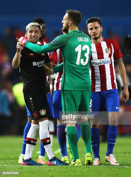 Kevin Kampl of Bayer Leverkusen congratulates Jan Oblak of Atletico Madrid after the UEFA Champions League Round of 16 second leg match between Club...