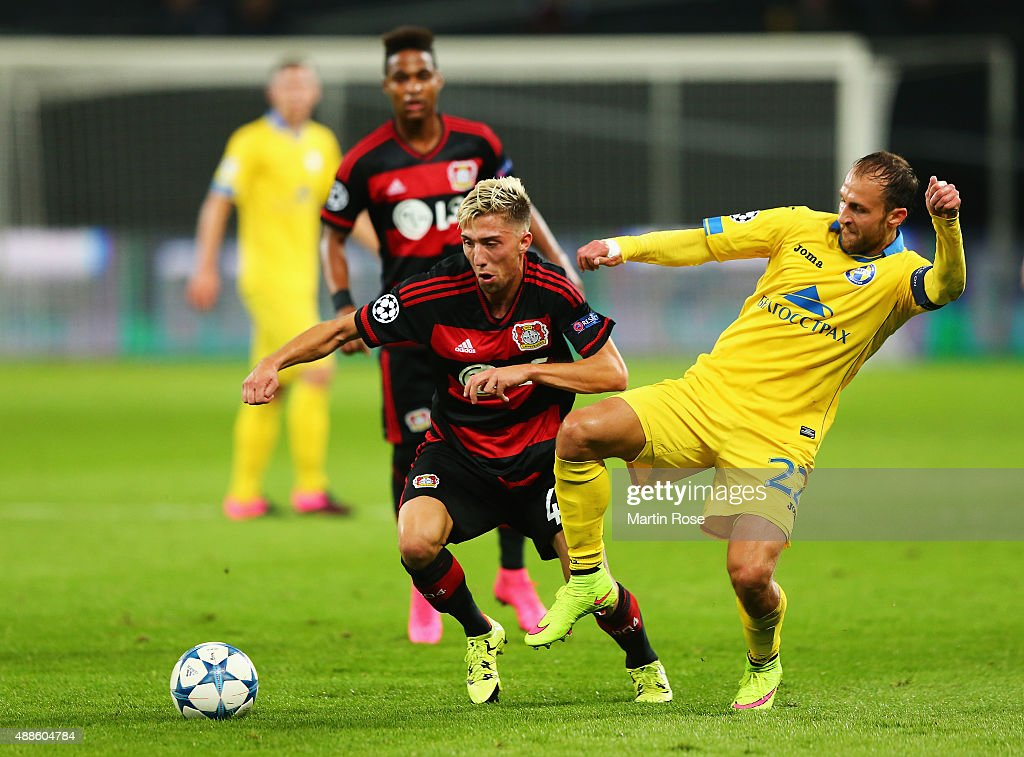Kevin Kampl of Bayer Leverkusen is challenged by Igor Stasevich of BATE during the UEFA Champions League Group E match between Bayer 04 Leverkusen and FC BATE Borisov at BayArena on September 16, 2015 in Leverkusen, Germany.