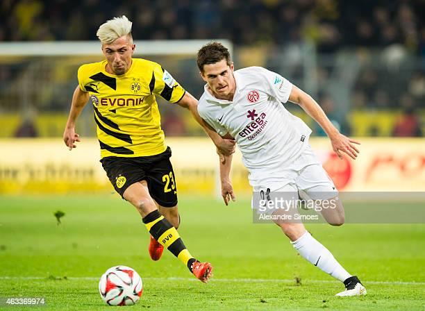 Kevin Kampl of Borussia Dortmund challenges Jonas Hofmann of Mainz during the Bundesliga match between Borussia Dortmund and 1 FSV Mainz 05 at Signal...