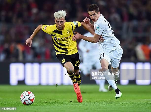 Kevin Kampl of Borussia Dortmund is challenged by Jonas Hofmann of 1 FSV Mainz 05 during the Bundesliga match between Borussia Dortmund and 1 FSV...