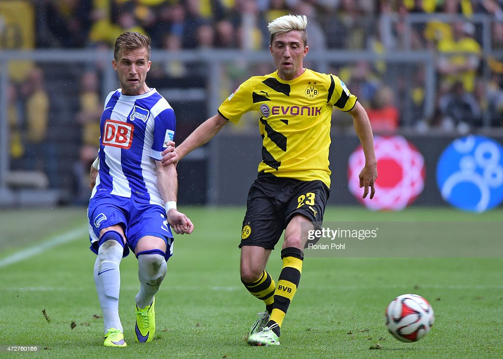 <a gi-track='captionPersonalityLinkClicked' href=/galleries/search?phrase=Kevin+Kampl&family=editorial&specificpeople=6527116 ng-click='$event.stopPropagation()'>Kevin Kampl</a> of Borussia Dortmund passes the ball against <a gi-track='captionPersonalityLinkClicked' href=/galleries/search?phrase=Peter+Pekarik&family=editorial&specificpeople=5577121 ng-click='$event.stopPropagation()'>Peter Pekarik</a> of Hertha BSC during the game between Borussia Dortmund and Hertha BSC on May 9, 2015 in Dortmund, Germany.