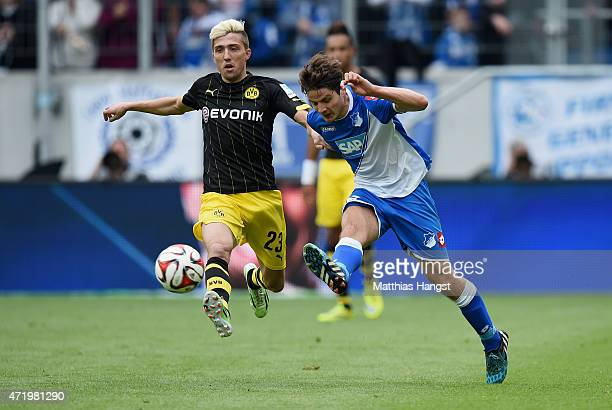 Kevin Kampl of Dortmund and Pirmin Schwegler of Hoffenheim compete for the ball during the Bundesliga match between 1899 Hoffenheim and Borussia...