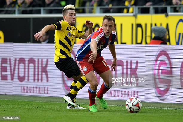 Kevin Kampl of Dortmund vies with Rafinha of Muenchen during the Bundesliga match between Borussia Dortmund and FC Bayern Muenchen at Signal Iduna...