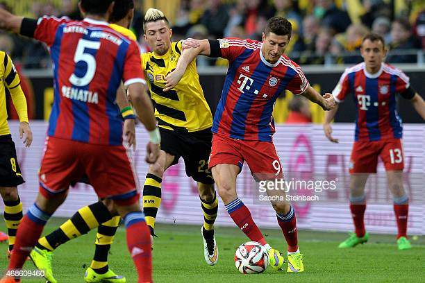 Kevin Kampl of Dortmund vies with Robert Lewandowski of Muenchen during the Bundesliga match between Borussia Dortmund and FC Bayern Muenchen at...