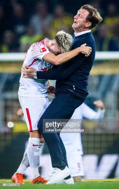 Kevin Kampl of Leipzig and Head Coach Ralph Hasenhuettl of Leipzig celebrate after the Bundesliga match between Borussia Dortmund and RB Leipzig at...