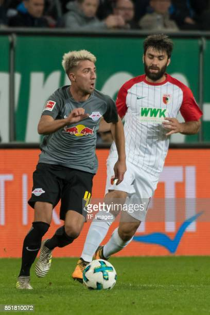 Kevin Kampl of Leipzig and Jan Moravek of Augsburg battle for the ball during the Bundesliga match between FC Augsburg and RB Leipzig at WWKArena on...