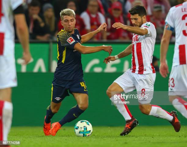 Kevin Kampl of Leipzig and Milos Jojic of Koeln battle for the ball during the Bundesliga match between 1 FC Koeln and RB Leipzig at...