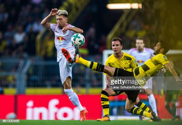 Kevin Kampl of Leipzig and Nuri Sahin of Dortmund fight for the ball during the Bundesliga match between Borussia Dortmund and RB Leipzig at Signal...