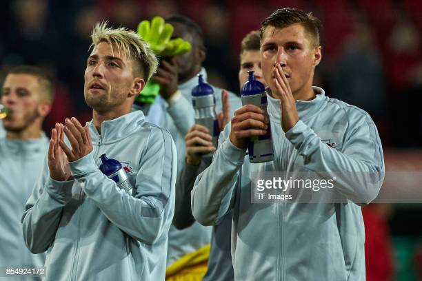 Kevin Kampl of Leipzig and Willi Orban of Leipzig looks on during the Bundesliga match between FC Augsburg and RB Leipzig at WWKArena on September 19...
