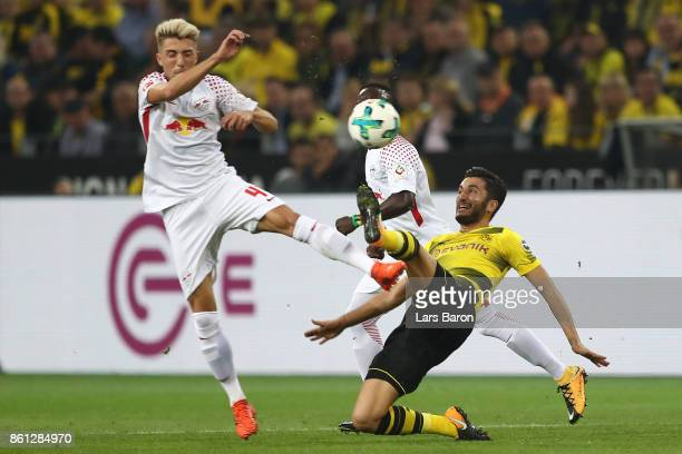 Kevin Kampl of Leipzig fights for the ball with Nuri Sahin of Dortmund during the Bundesliga match between Borussia Dortmund and RB Leipzig at Signal...