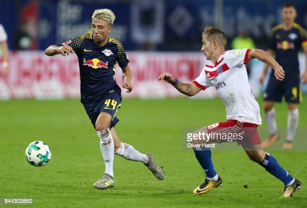 Kevin Kampl of Leipzig is challenged by Lewis Holtby of Hamburg during the Bundesliga match between Hamburger SV and RB Leipzig at Volksparkstadion...