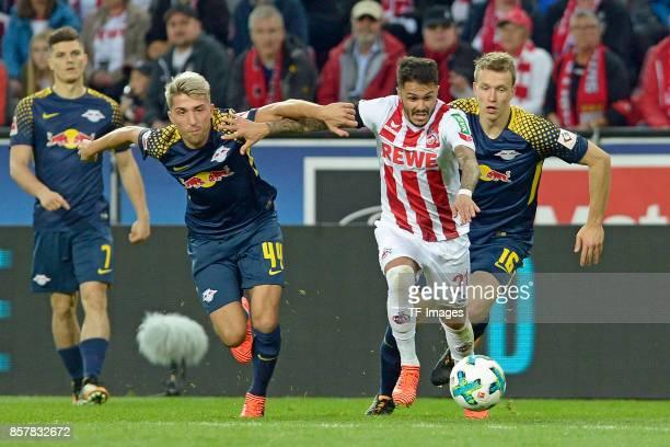 Kevin Kampl of Leipzig Leonardo Bittencourtof Koeln Lukas Klostermann of Leipzig battle for the ball during the Bundesliga match between 1 FC Koeln...