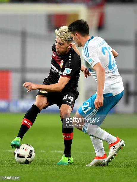 Kevin Kampl of Leverkusen and Alesssandro Schoepf of Schalke battle for the ball during the Bundesliga match between Bayer 04 Leverkusen and FC...