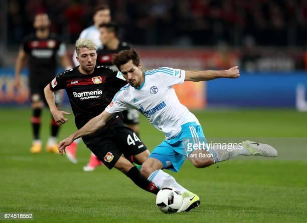 Kevin Kampl of Leverkusen and Benjamin Stambouli of Schalke battle for the ball during the Bundesliga match between Bayer 04 Leverkusen and FC...