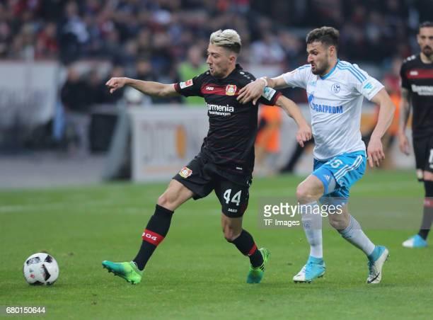 Kevin Kampl of Leverkusen and Daniel Caligiuri of Schalke battle for the ball during to the Bundesliga match between Bayer 04 Leverkusen and FC...