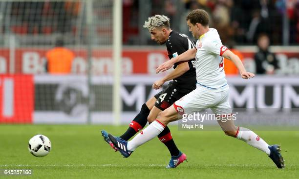 Kevin Kampl of Leverkusen and Fabian Frei of Mainz battle for the ball during the Bundesliga match between Bayer 04 Leverkusen and 1 FSV Mainz 05 at...