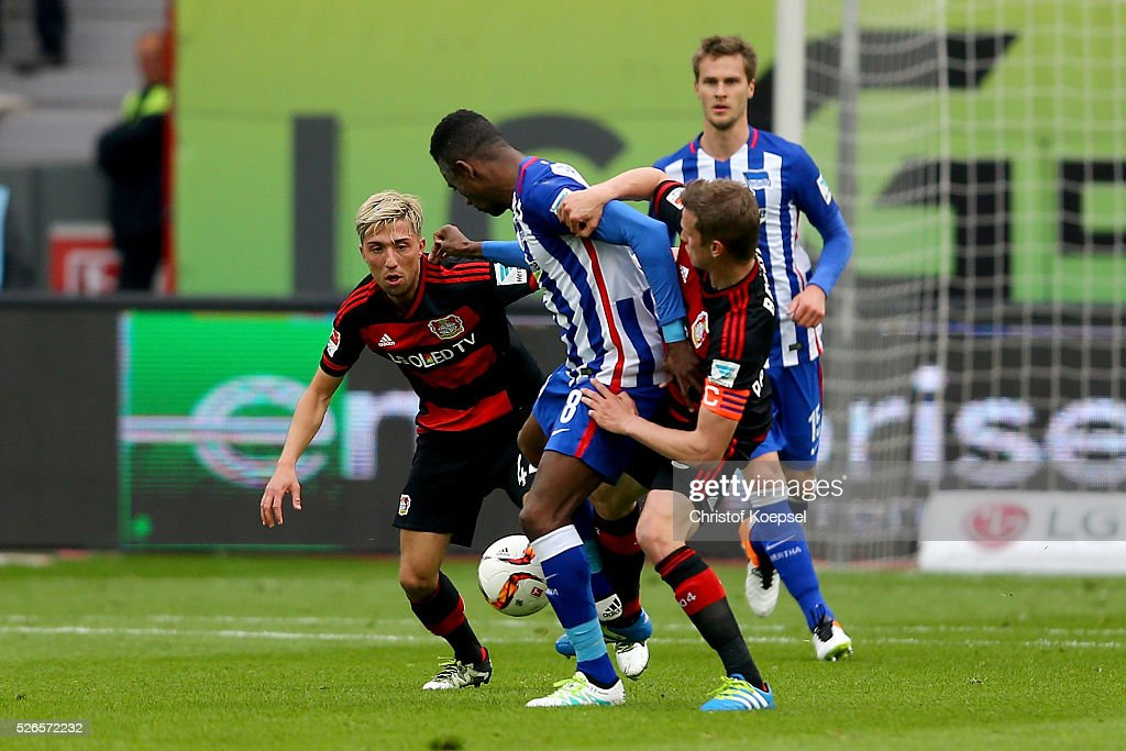 Kevin Kampl of Leverkusen (L) and Lars Bender of Leverkusen (R) challenge Salomon Kalou of Berlin (C) during the Bundesliga match between Bayer Leverkusen and Hertha BSC Berlin at BayArena on April 30, 2016 in Leverkusen, Germany.