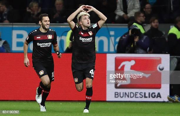 Kevin Kampl of Leverkusen celebrates his team's first goal with team mate Hakan Calhanoglu during the Bundesliga match between Bayer 04 Leverkusen...