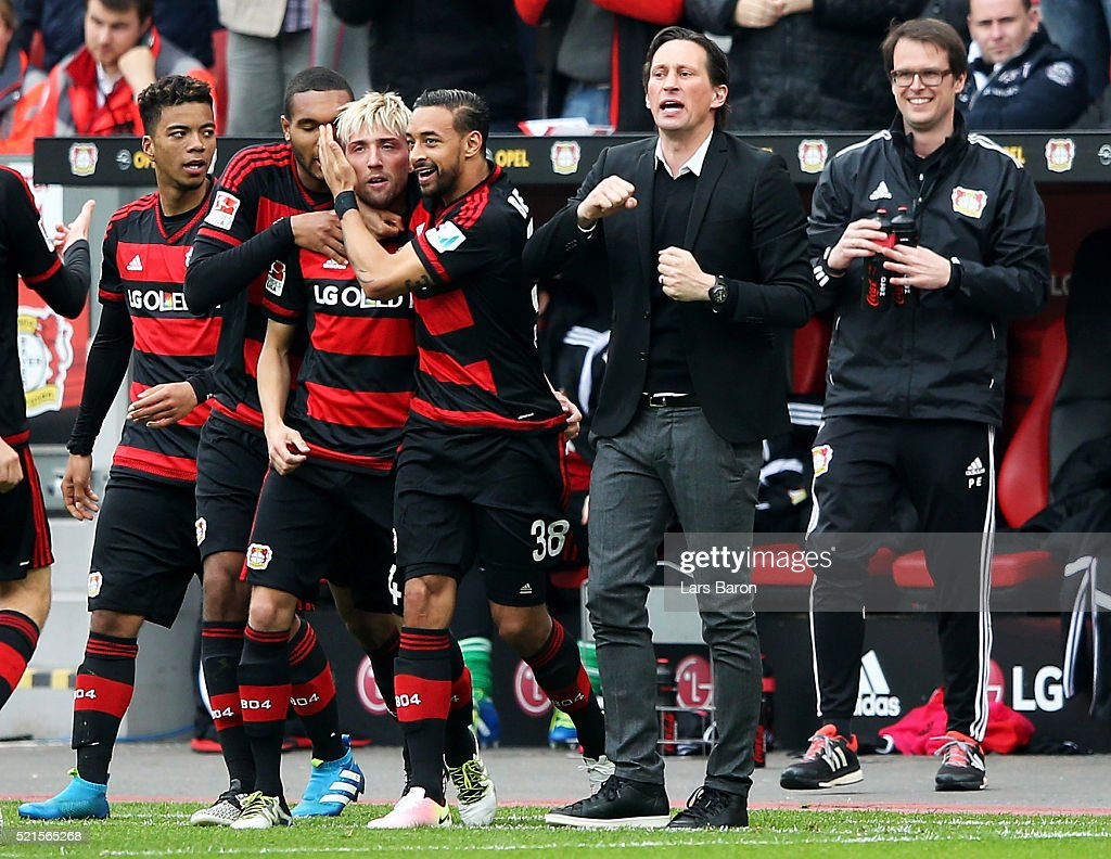 <a gi-track='captionPersonalityLinkClicked' href=/galleries/search?phrase=Kevin+Kampl&family=editorial&specificpeople=6527116 ng-click='$event.stopPropagation()'>Kevin Kampl</a> of Leverkusen celebrates next to head coach <a gi-track='captionPersonalityLinkClicked' href=/galleries/search?phrase=Roger+Schmidt+-+Soccer+Manager&family=editorial&specificpeople=13515848 ng-click='$event.stopPropagation()'>Roger Schmidt</a> after scoring his teams first goal during the Bundesliga match between Bayer Leverkusen and Eintracht Frankfurt at BayArena on April 16, 2016 in Leverkusen, Germany.