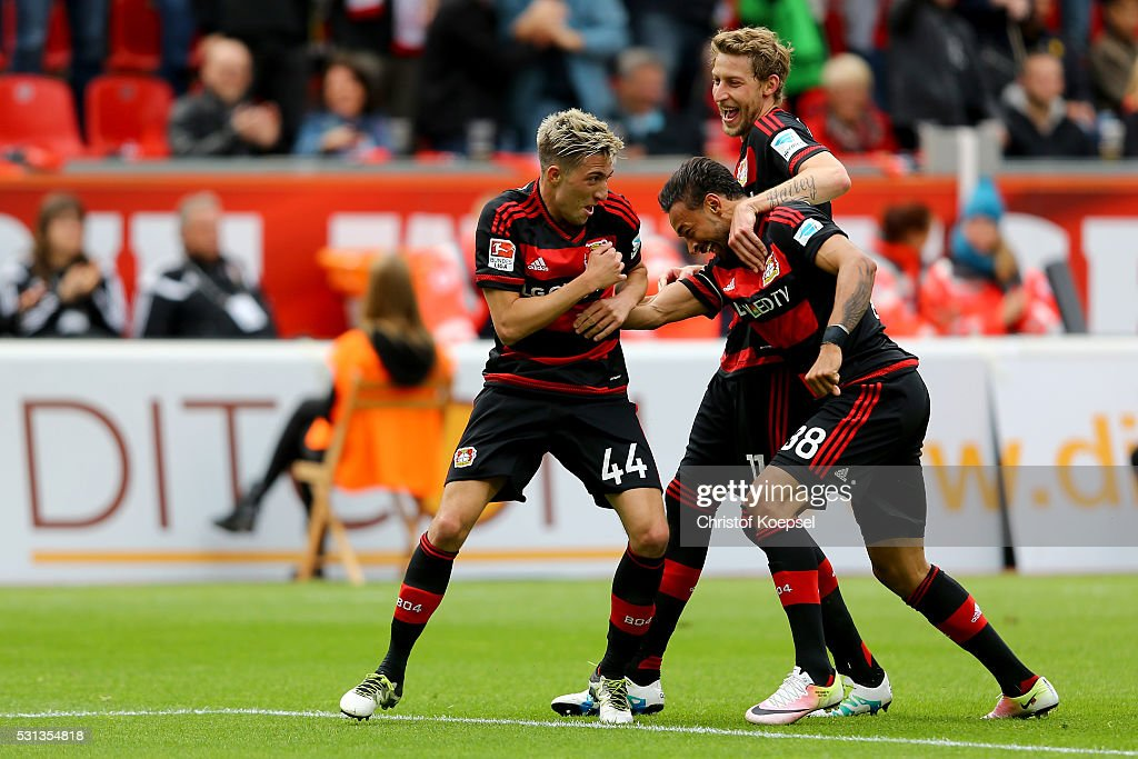<a gi-track='captionPersonalityLinkClicked' href=/galleries/search?phrase=Kevin+Kampl&family=editorial&specificpeople=6527116 ng-click='$event.stopPropagation()'>Kevin Kampl</a> of Leverkusen (L) celebrates the second goal with <a gi-track='captionPersonalityLinkClicked' href=/galleries/search?phrase=Karim+Bellarabi&family=editorial&specificpeople=7158972 ng-click='$event.stopPropagation()'>Karim Bellarabi</a> (C) and <a gi-track='captionPersonalityLinkClicked' href=/galleries/search?phrase=Stefan+Kiessling&family=editorial&specificpeople=605405 ng-click='$event.stopPropagation()'>Stefan Kiessling</a> of Leverkusen (R) during the Bundesliga match between Bayer Leverkusen and FC Ingolstadt at BayArena on May 14, 2016 in Leverkusen, Germany.