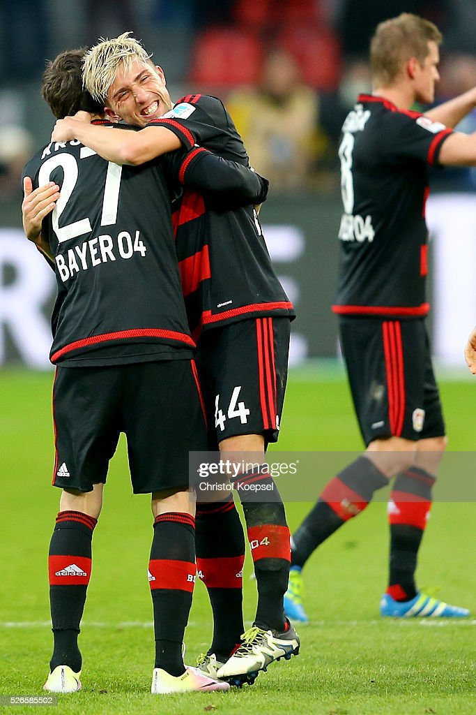 <a gi-track='captionPersonalityLinkClicked' href=/galleries/search?phrase=Kevin+Kampl&family=editorial&specificpeople=6527116 ng-click='$event.stopPropagation()'>Kevin Kampl</a> of Leverkusen (R) embarces <a gi-track='captionPersonalityLinkClicked' href=/galleries/search?phrase=Robbie+Kruse&family=editorial&specificpeople=4449553 ng-click='$event.stopPropagation()'>Robbie Kruse</a> of Leverkusen (L) after the Bundesliga match between Bayer Leverkusen and Hertha BSC Berlin at BayArena on April 30, 2016 in Leverkusen, Germany. The match between Leverkusen and Belrin ended 2-1.