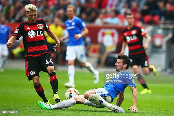 Kevin Kampl of Leverkusen is challenged by Jerome Gondorf of Darmstadt during the Bundesliga match between Bayer Leverkusen and SV Darmstadt 98 at...