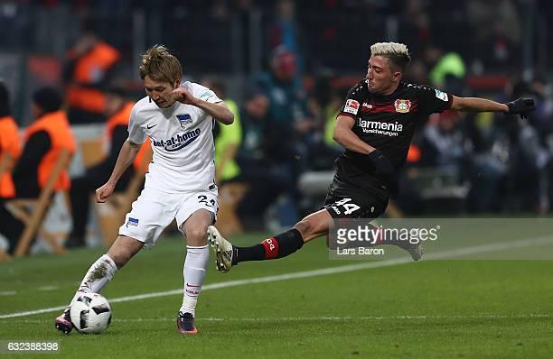 Kevin Kampl of Leverkusen is challenges Genki Haraguchi of Berlin during the Bundesliga match between Bayer 04 Leverkusen and Hertha BSC at BayArena...