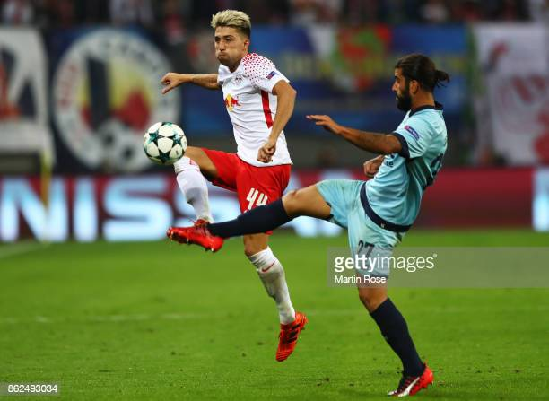 Kevin Kampl of RB Leipzig and Sergio Oliveira of FC Porto battle for possession during the UEFA Champions League group G match between RB Leipzig and...