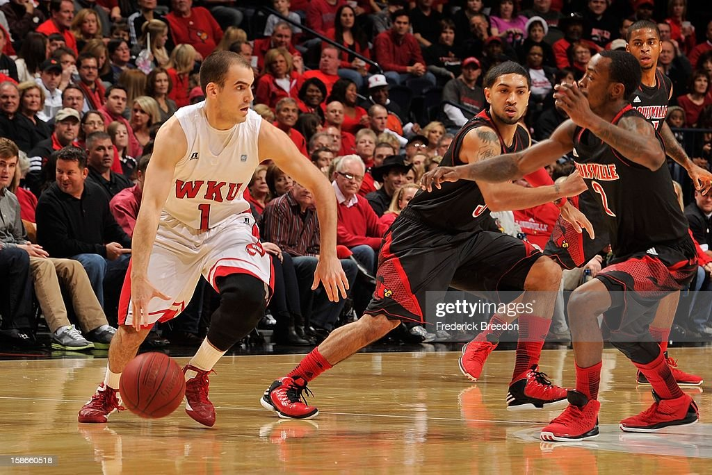 Kevin Kaspar #1 of the Western Kentucky Hilltoppers dribbles against Russ Smith #2 of the Louisville Cardinals at Bridgestone Arena on December 22, 2012 in Nashville, Tennessee.