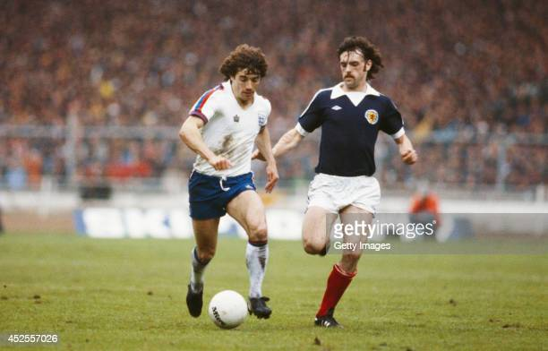 Kevin Keegan of England holds off a challenge from John Wark during the Home International match between England and Scotland at Wembley Stadium on...