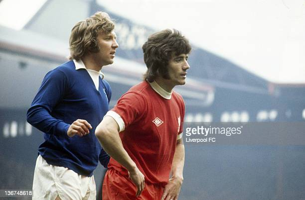 Kevin Keegan of Liverpool is closely marked by Mick Barnard of Everton in the Merseyside derby during the Football League Division One match between...