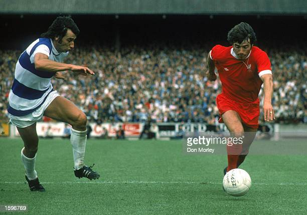 Kevin Keegan of Liverpool looks to take the ball past Dave Clement of Queens Park Rangers during the League Division One match held on August 16 1975...
