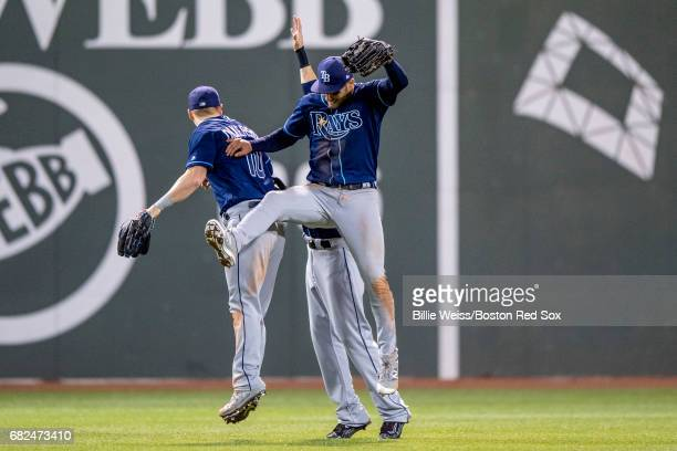 Kevin Kiermaier Corey Dickerson and Colby Rasmus of the Tampa Bay Rays celebrate a victory against the Boston Red Sox on May 12 2017 at Fenway Park...
