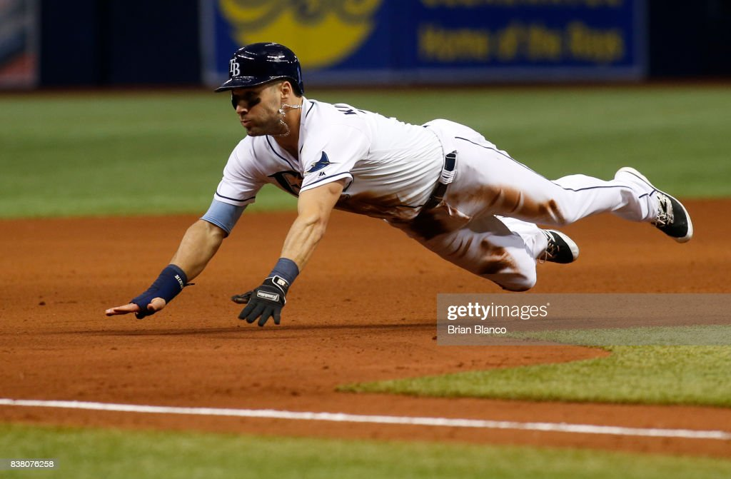 Kevin Kiermaier #39 of the Tampa Bay Rays advances to third base off of the throwing error by catcher Raffy Lopez of the Toronto Blue Jays during the seventh inning of a game on August 23, 2017 at Tropicana Field in St. Petersburg, Florida.