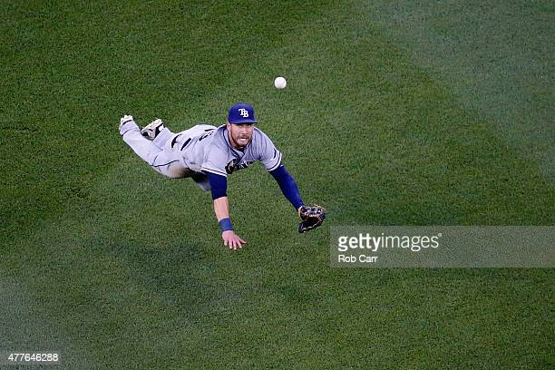 Kevin Kiermaier of the Tampa Bay Rays can't reach an RBI single hit by Yunel Escobar of the Washington Nationals during the second inning at...