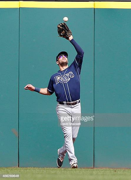 Kevin Kiermaier of the Tampa Bay Rays catches a ball hit by Carlos Santana during the first inning of their game on September 28 2014 at Progressive...