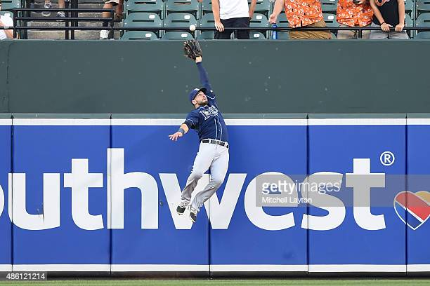 Kevin Kiermaier of the Tampa Bay Rays catches a fly ball hit by Manny Machado of the Baltimore Orioles in the first inning during a baseball game at...