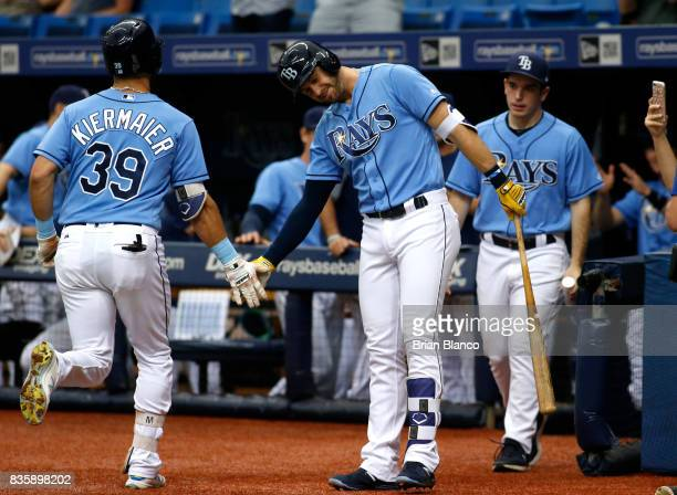 Kevin Kiermaier of the Tampa Bay Rays celebrates with teammate Evan Longoria after hitting a home run off of pitcher Yovani Gallardo of the Seattle...