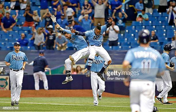 Kevin Kiermaier of the Tampa Bay Rays celebrates with teammate Tim Beckham after hitting a walkoff RBI single to score Evan Longoria to end the ninth...