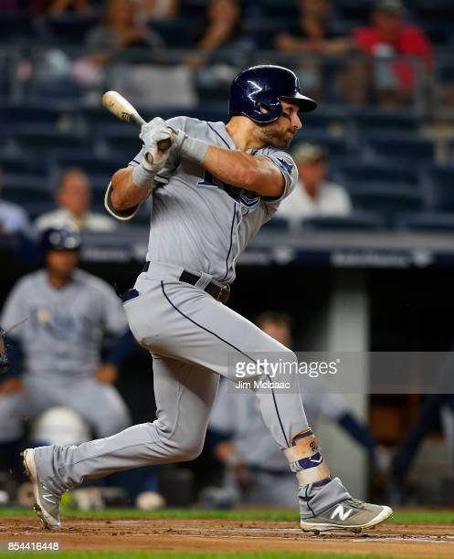 Kevin Kiermaier of the Tampa Bay Rays follows through on a first inning single against the New York Yankees at Yankee Stadium on September 26 2017 in...