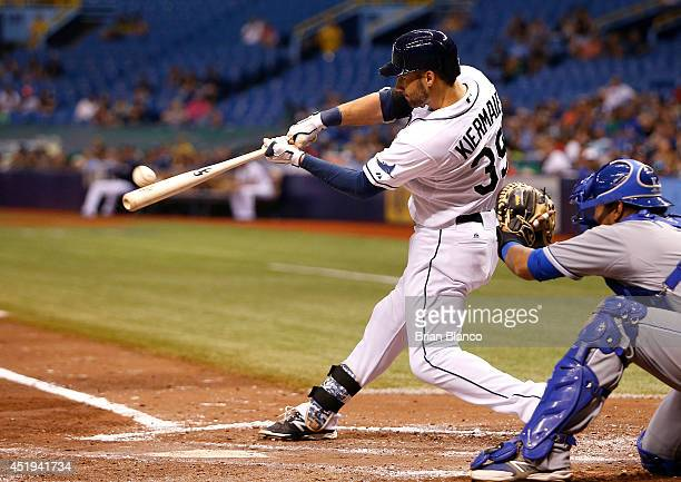 Kevin Kiermaier of the Tampa Bay Rays hits a grand slam home run in front of catcher Salvador Perez of the Kansas City Royals during the fourth...