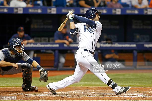 Kevin Kiermaier of the Tampa Bay Rays hits an RBI double in front of catcher Alex Avila of the Detroit Tigers to score Steven Souza Jr #20 during the...