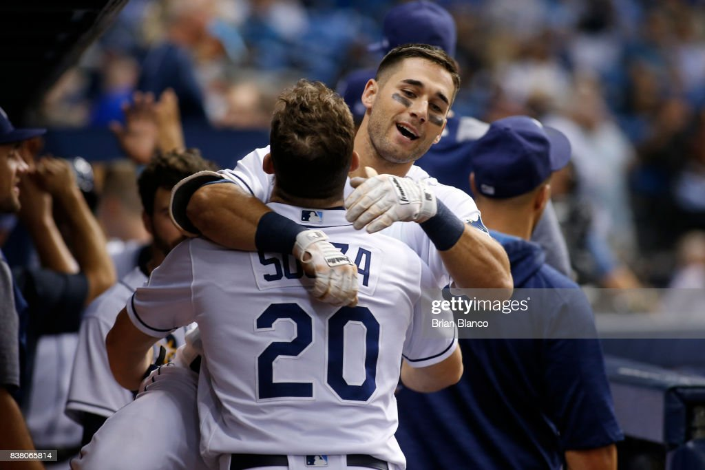 Kevin Kiermaier #39 of the Tampa Bay Rays leaps into the arms of teammate Steven Souza Jr. #20 after hitting a two-run home run off of pitcher Marcus Stroman of the Toronto Blue Jays during the third inning of a game on August 23, 2017 at Tropicana Field in St. Petersburg, Florida.