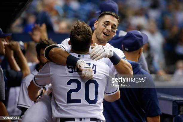 Kevin Kiermaier of the Tampa Bay Rays leaps into the arms of teammate Steven Souza Jr #20 after hitting a tworun home run off of pitcher Marcus...