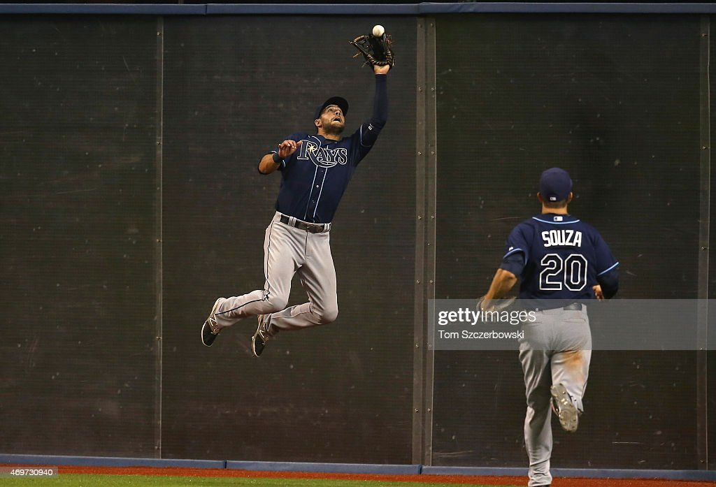 Kevin Kiermaier of the Tampa Bay Rays makes a catch against the wall in the ninth inning during MLB game action against the Toronto Blue Jays on...